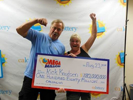Rick Knudsen with his wife accepting the $180 million check.