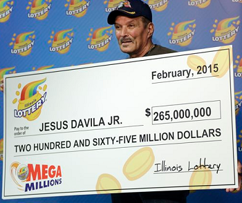 Jesus Davila Jr. with his $265 Mega millions jackpot winning check