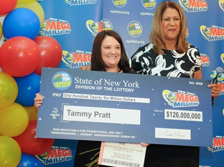 Tammy Pratt (left) of South Fallsburg, with New York Lottery spokeswoman Yolanda Vega.
