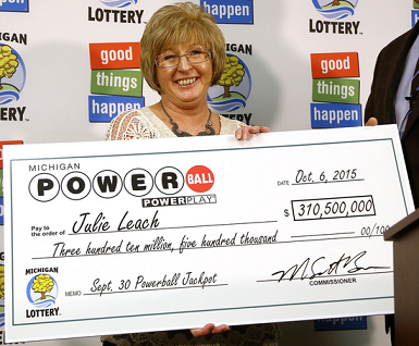 Julie Leach claims her $310.5 million Powerball prize